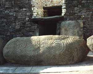 Newgrange, Ireland - the carved monolith at the entrance. Copywright McDeil.